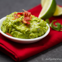 Roasted Jalapeno & Garlic Bacon Guacamole: Smooth, creamy and loaded with crispy bacon!